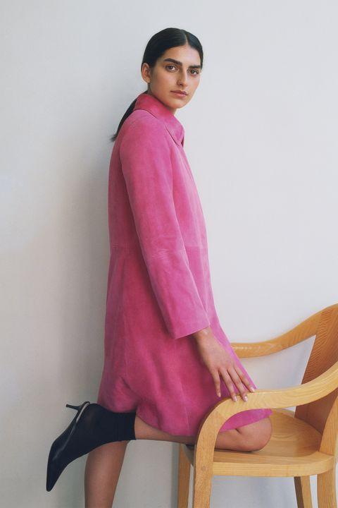 Clothing, Pink, Magenta, Sitting, Leg, Fashion, Outerwear, Neck, Textile, Photo shoot,