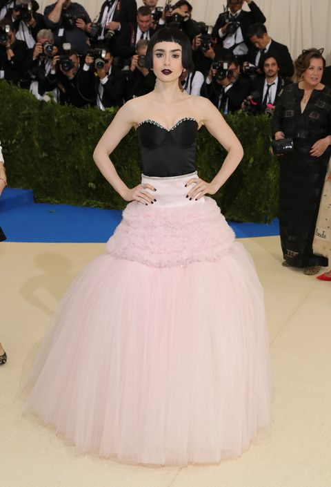 Model Lily Collins with an edge look wearing Giambattista Valli Haute Couture