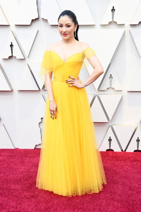 Dress, Clothing, Gown, Yellow, Shoulder, Red carpet, Fashion model, Carpet, A-line, Flooring,