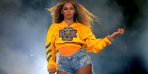 Fashion model, Yellow, Clothing, Fashion, Thigh, Performance, Orange, Music artist, Jeans, Outerwear,