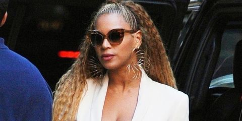 *EXCLUSIVE* Beyonce covers her stomach amid pregnancy rumors as she heads out with Jay-Z