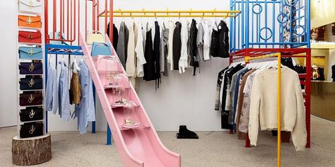 Clothes hanger, Boutique, Room, Closet, Furniture, Wardrobe, Outlet store, Dry cleaning, Building, Interior design,