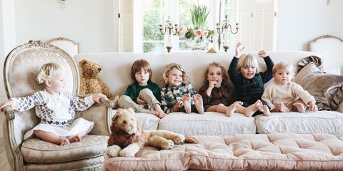People, Room, Child, Couch, Furniture, Family pictures, Living room, Family taking photos together, Sporting Group, Family,