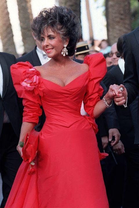 Dress, Gown, Clothing, Red, Shoulder, Formal wear, Fashion, Event, Flooring, Carpet,
