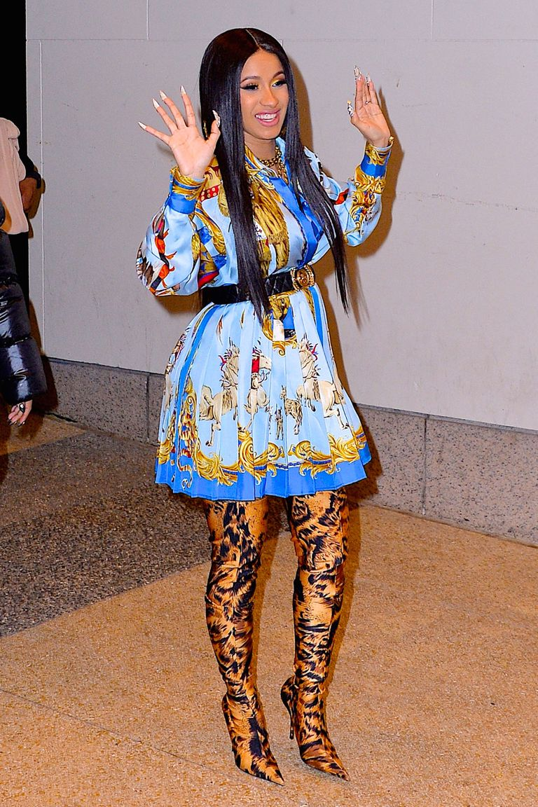 5befd450770 In a belted Versace dress and printed thigh-high Balenciaga boots while out  in NYC.