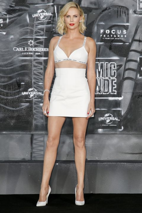 af9bcc36d52c9 Charlize Theron Wore Nothing But A Dior Bra   Mini Skirt On The Red Carpet