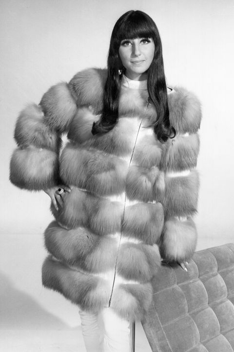 circa 1966  entertainer cher poses for a portrait wearing a fur coat in circa 1966 photo by michael ochs archivesgetty images