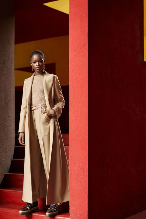Fashion, Formal wear, Outerwear, Statue, Art, Fashion design,
