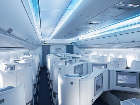 Aircraft cabin, Room, Architecture, Airline, Ceiling, Interior design, Building, Cabin, Airliner, Metal,