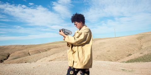 young female artist filming in the desert