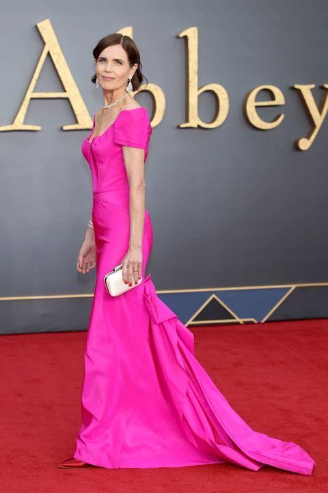 Clothing, Dress, Shoulder, Flooring, Magenta, Pink, Formal wear, Style, Carpet, Fashion accessory,