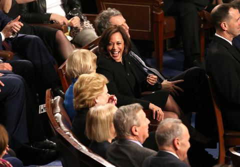 Senators Harris and Warren talk as U.S. President Trump delivers his second State of the Union address to a joint session of the U.S. Congress in Washington