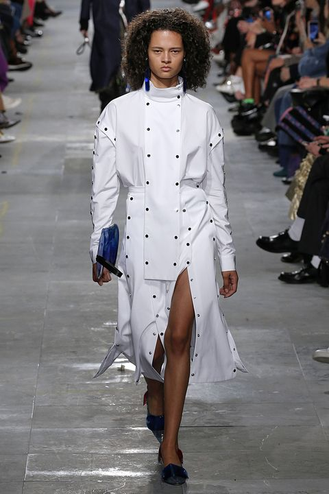 Fashion model, Fashion, White, Clothing, Fashion show, Runway, Coat, Haute couture, Street fashion, Public event,