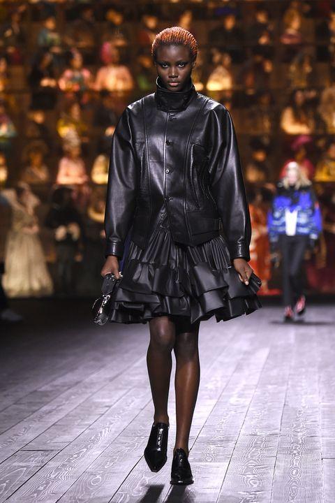 Fashion model, Runway, Fashion, Fashion show, Clothing, Shoulder, Outerwear, Public event, Human, Street fashion,