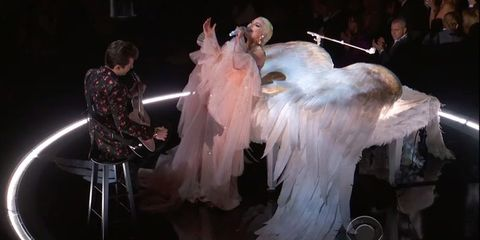 Fashion, Performance art, Dress, Event, Performance, Fur, Costume, Feather, Fictional character, Haute couture,