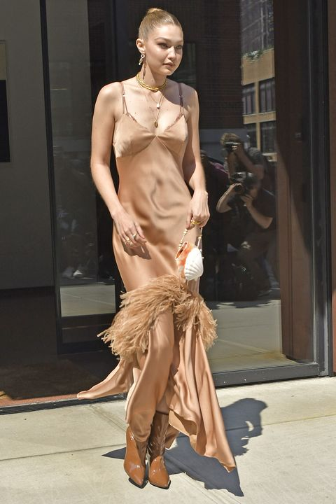 a8a5438860e4ec Gigi Hadid Wears A Cream Colored Nightgown Fringe Dress With Pearl Accented  Leather Handbag On Her
