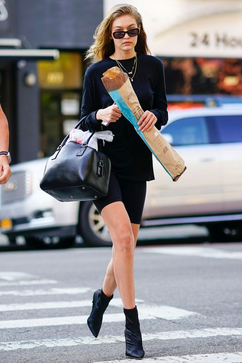 d83685d435 Gigi Hadid walks with a piece of long French bread in New York