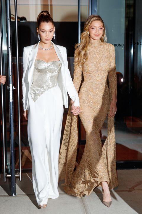 Gigi And Bella Hadid Wear Gold And Silver Dresses Gigi