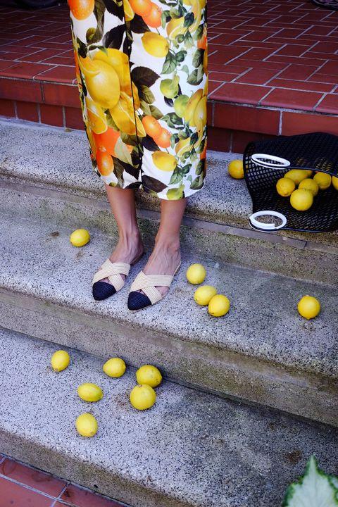 Yellow, Footwear, Street fashion, Shoe, rubber ducky, Leg, Human leg, Dress, Sidewalk, Plant,