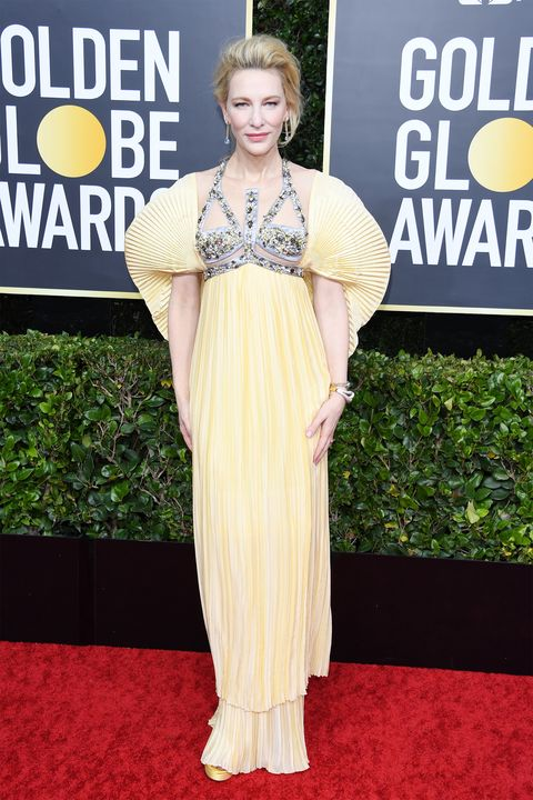 Clothing, Red carpet, Dress, Shoulder, Carpet, Premiere, Yellow, Hairstyle, Fashion, Flooring,