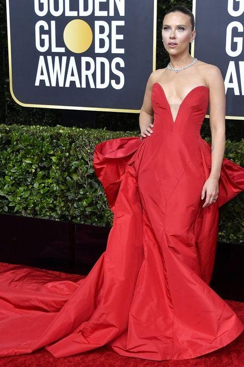 Red carpet, Dress, Carpet, Clothing, Red, Gown, Flooring, Premiere, Fashion, Shoulder,