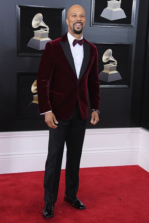 Suit, Red carpet, Carpet, Formal wear, Tuxedo, Clothing, Flooring, Outerwear, Pantsuit, Blazer,