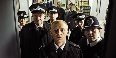 HOT FUZZ, Simon Pegg (front, center), Nick Frost (front right), 2007. ©Rogue Pictures/courtesy Evere