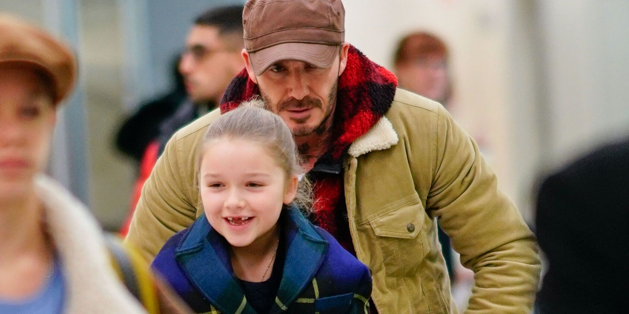Harper Beckham had the best transport at the airport thanks to dad David Beckham as they arrived in NYC