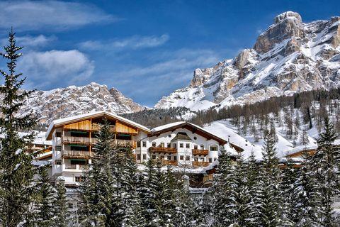 Snow, Mountain, Mountain village, Winter, Mountainous landforms, Property, House, Home, Sky, Mountain range,