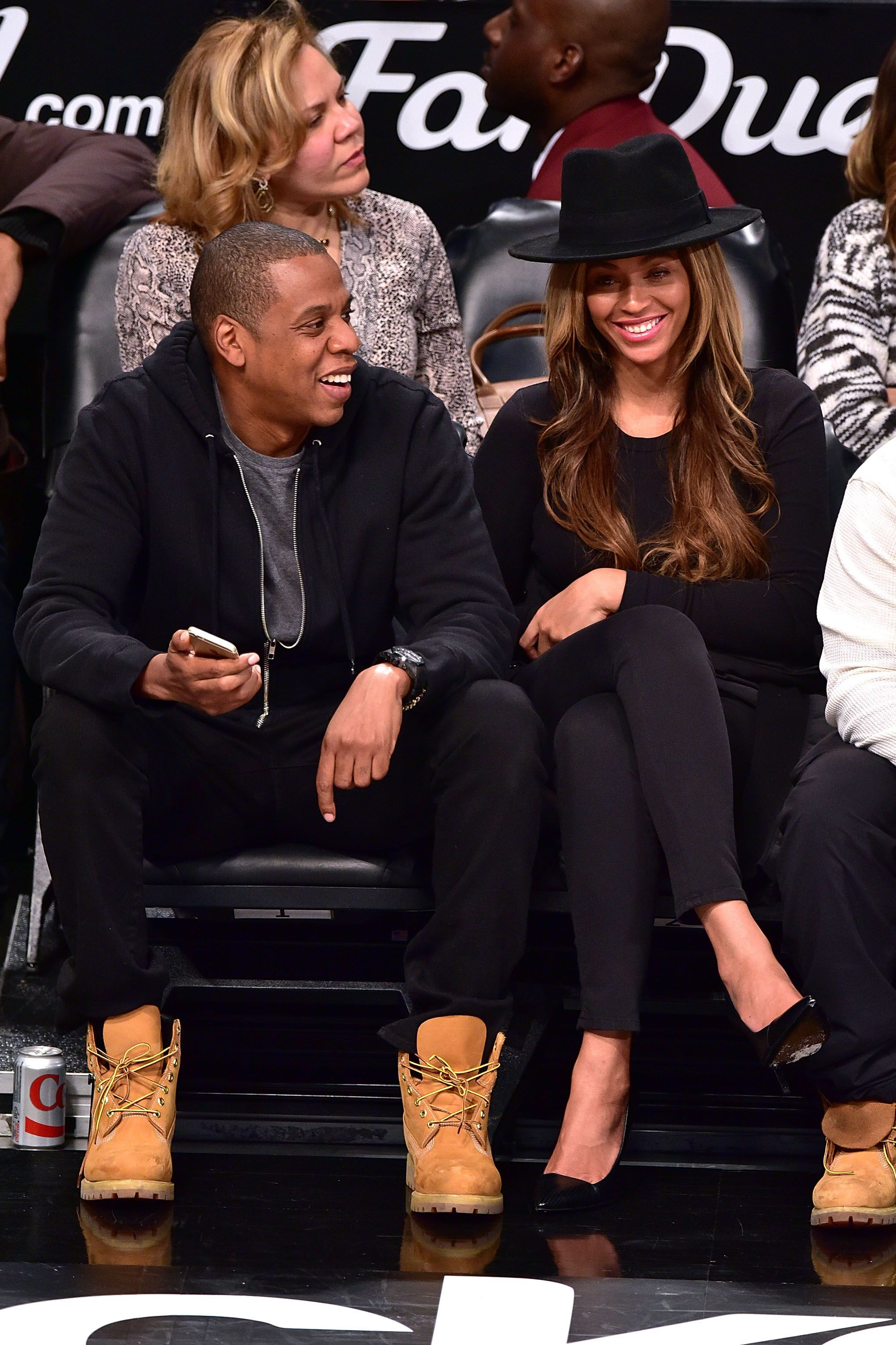 JAY-Z and Beyoncé sit courtside at a Rockets game in 2015.
