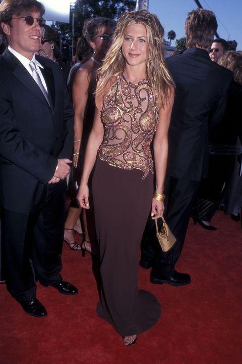 Clothing, Carpet, Red carpet, Dress, Premiere, Fashion, Event, Suit, Flooring, Formal wear,
