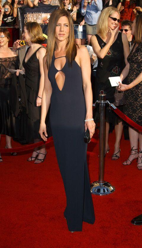 Red carpet, Carpet, Dress, Clothing, Premiere, Flooring, Little black dress, Shoulder, Event, Fashion,