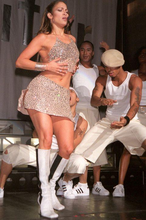 Fashion, Dancer, Thigh, Leg, Fashion model, Performance, Event, Dance, Footwear, Performance art,