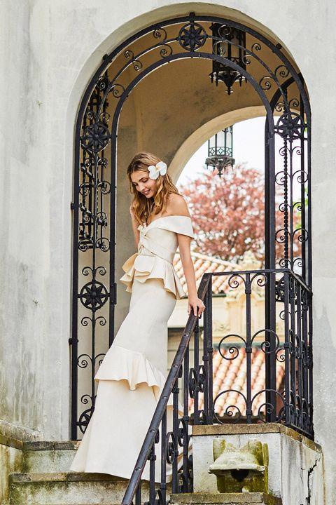 Dress, Bridal clothing, Petal, Beauty, Wedding dress, Bride, Arch, Gown, Embellishment, Waist,
