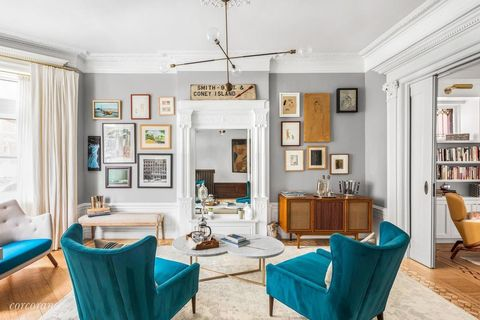 Living room, Room, Furniture, Interior design, Property, Turquoise, Building, Ceiling, Home, Table,