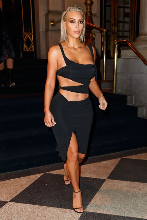 e8efe8dc3660c Rocking a sexy take on the little black dress, Kim wore one with major  cutouts that put her toned abs on display while out in NYC in 2017.