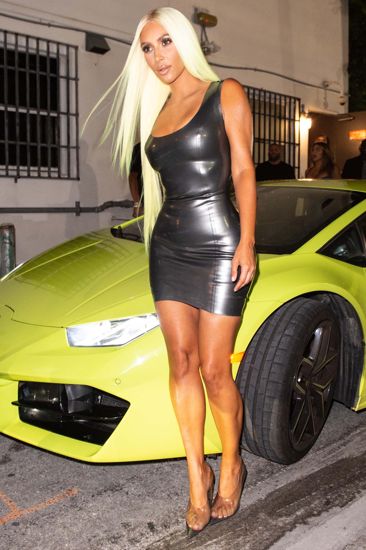 Glamorpuss Kim Kardashian sports green locks as she heads out with pal Larsa Pippen in a sports car.