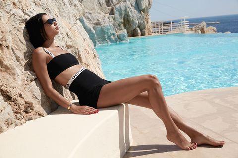 Clothing, Leg, Beauty, Human leg, Thigh, Bikini, Summer, Fashion, Vacation, Model,