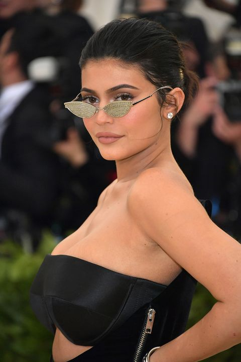 2018Jenner hit the Met Gala red carpet in 2018 wearing a casual chignon and retro-glam makeup.