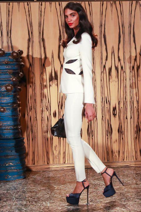 Clothing, White, Fashion model, Fashion, Waist, Photo shoot, Jeans, Leg, Street fashion, Footwear,