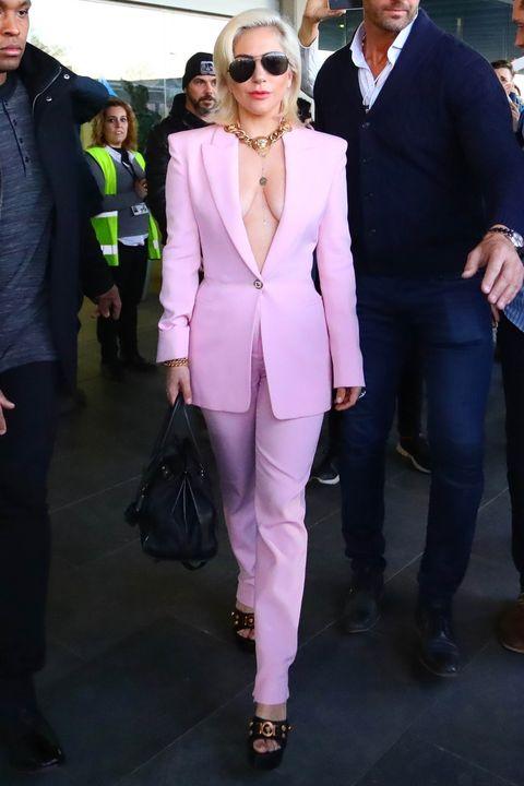 Suit, Clothing, Eyewear, Pantsuit, Fashion, Blazer, Formal wear, Pink, Street fashion, Outerwear,