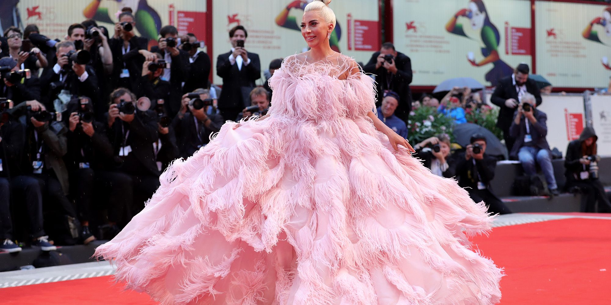 Lady Gaga Wears Pink Feathered Valentino Couture Gown to Venice Film ...