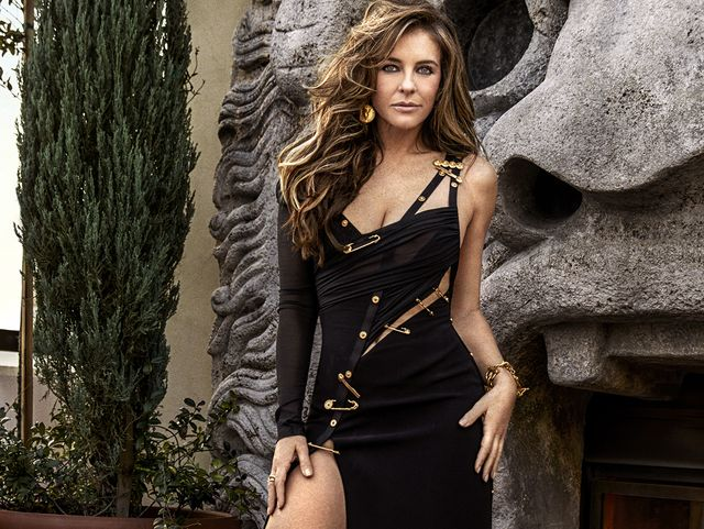 5bad18af94c9 Elizabeth Hurley Recreates Famous Versace Pin Dress and Reveals What ...