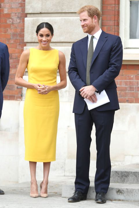 Meghan Markle Channels Amal Clooneys Royal Wedding Yellow Hot