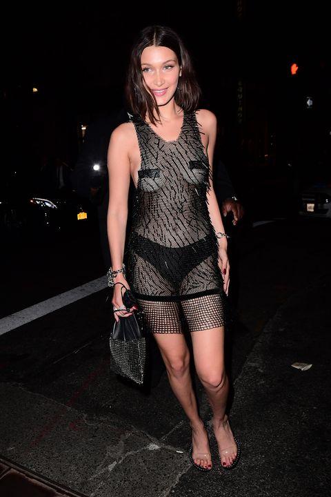 Human leg, Dress, Fashion, Thigh, Darkness, Midnight, Fashion model, Flash photography, Day dress, Foot,