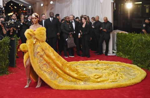 Yellow, Carpet, Flooring, Red carpet, Tradition, Dress, Fun, Event, Temple,