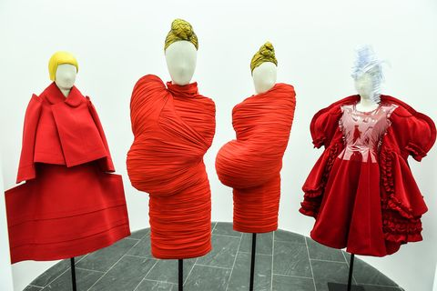 Red, Mannequin, Clothing, Outerwear, Yellow, Fashion, Dress, Costume, Textile, Fashion design,
