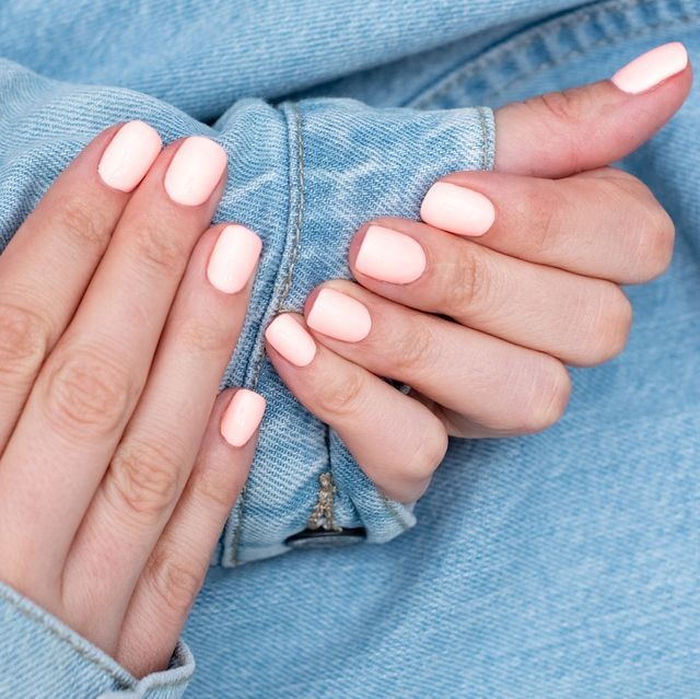 manicure in mint color on the white mint background