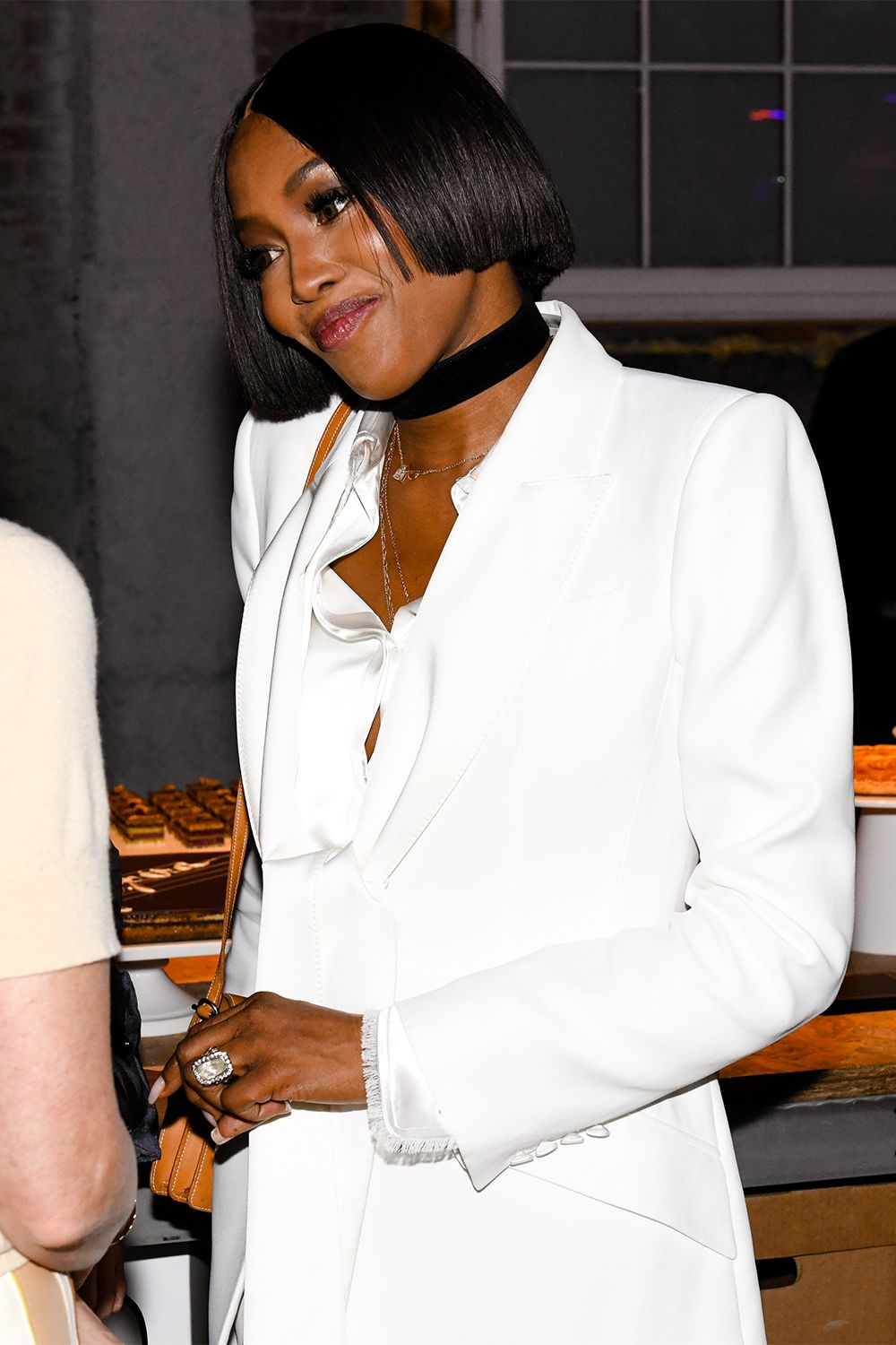 Naomi Campbell Sells Us on the White Winter Suit