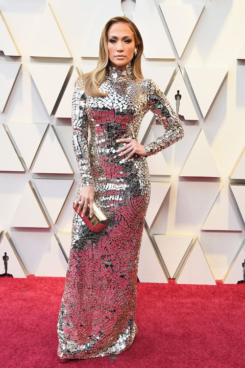Red carpet, Fashion model, Clothing, Dress, Carpet, Flooring, Shoulder, Gown, Fashion, Hairstyle,